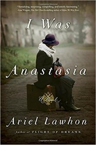 Book Cover Image of Ariel Lawhon's historical fiction novel titled I Was Anastasia. The image features a woman whose face is obscured by a hat in clothing from another decade perched delicately on top of a suitcase.